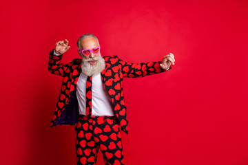 Portrait of his he nice attractive funky cool modern trendy gray-haired guy hipster MC dancing having fun isolated on bright vivid shine vibrant red color background