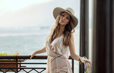 Portrait of sexy young woman in stylish hat