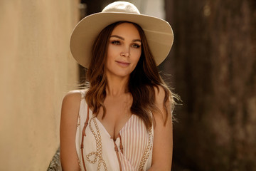 Portrait of sexy woman outdoor in hat