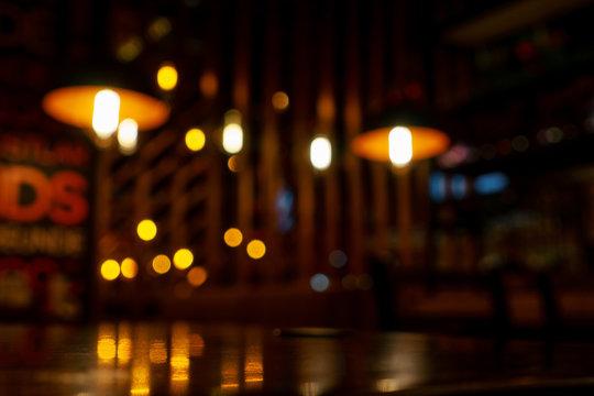 Blurred background in modern cafe, bokeh of lights.