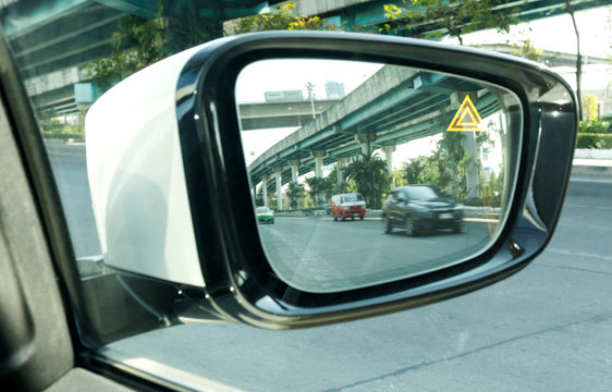Car Mirror blind spot detection system monitoring,  DRIVING ASSISTANT Technology that was developed for safety.