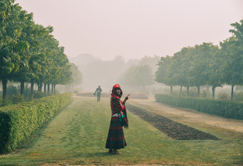 A woman in traditional saree at green park