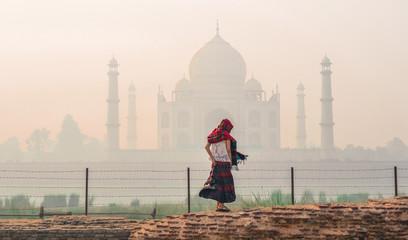 A woman visit Taj Mahal at early morning