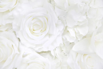 Keuken foto achterwand Roses Decoration artificial white roses flower bouquet as a floral background with soft focus and copy space.