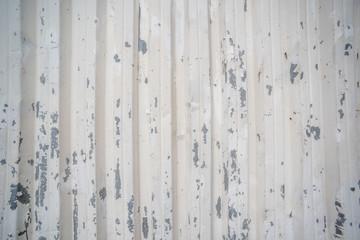 Surface of frayed corrugated fence