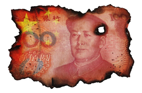 Burned fragment of Chinese Yuan banknote on white isolated background. Concept of financial crisis. Blackened charred edges of 100 China Yuan money