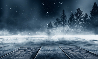 Photo sur Aluminium Bleu nuit Winter background. Winter snow landscape with wooden table in front. Dark winter forest background at night. Snow, fog, moonlight. Dark neon night background in the forest with moonlight.