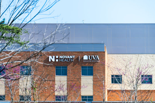 Gainesville, USA - April 18, 2018: UVA Health Novant system sign on hospital building for famous University College center