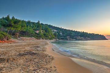 The sunrise at the beach Chrisi Milia of Alonissos, Greece