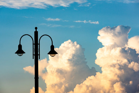 street lamps with a background of a spectacular sky