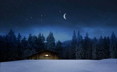 Wall Mural - Beleuchtete Holzhütte in einer Winternacht