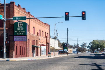 Rocky Ford, USA - October 13, 2019: Small town in Colorado with red light on main street downtown and first national bank