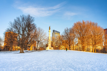 Soldiers and Sailors Monument in Boston common at winter sunset