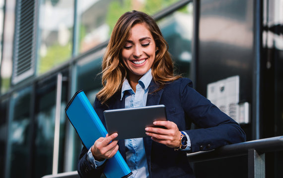Young businesswoman working with tablet outdoor. Business, education, lifestyle concept