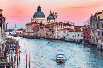 Photo sur Plexiglas Venice Cathedral Santa Maria della Salute tourists on gondola Grand Canal of Venice sunset, Italy