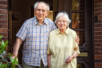 Elderly Couple at the Front Door