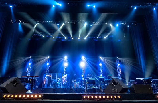 Bright beautiful rays of light on an stage before the concert.