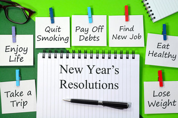 New Year's Resolutions written on a note paper and diary