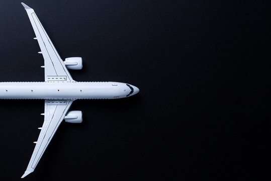 Aircraft model on black background, Top view with empty space. Concept of aircraft industry, airline safety, security and traveling insurance