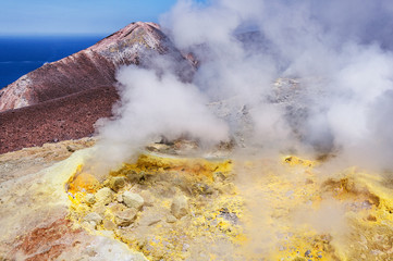 Smoke and sulfur by the top of volcano. Volcano island. Italy.