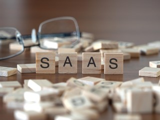 saas the word or concept represented by wooden letter tiles