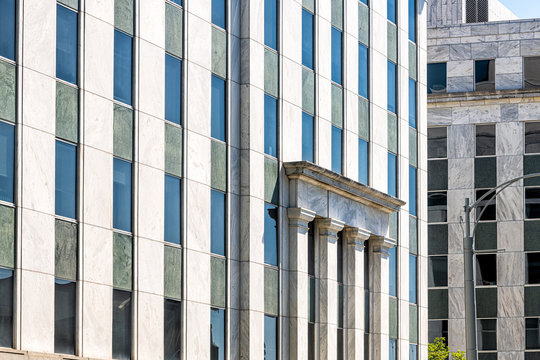 Atlanta, Georgia tower skyscraper building in downtown abstract exterior facade closeup with windows on walls sunny day