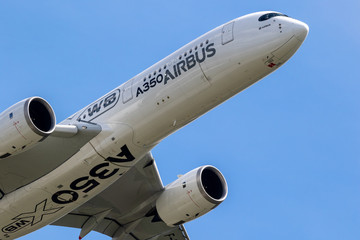 BERLIN - APR 27, 2018: New Airbus A350 XWB passenger plane performing at the Berlin ILA Air Show.