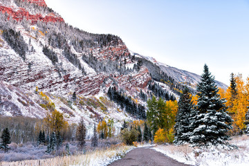 Door stickers Lavender Maroon Bells road to campground in Aspen, Colorado rocky mountain covered in snow after winter frozen in autumn 2019 with red mountains