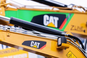 MUNICH / GERMANY - APRIL 14, 2019: Caterpillar logo on a digger arm at a CAT machine dealer.