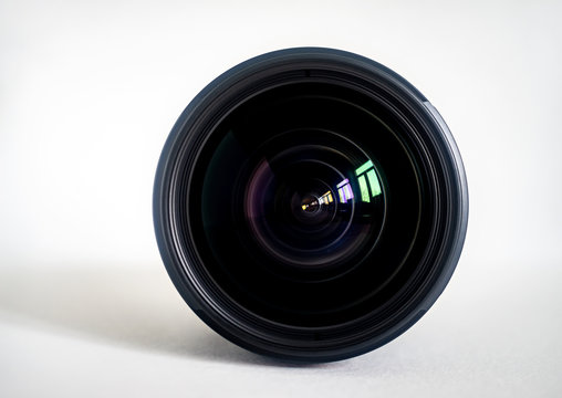 Objective lens of photo camera for photo or video  closeup on white background