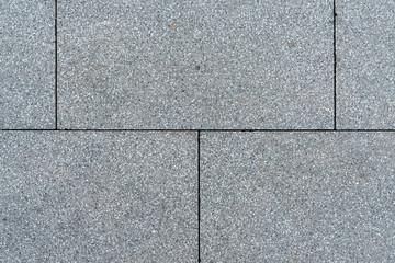 Texture of gray horizontal road granite tiles. Stone background. Modern paving slabs. Motley pattern. Fototapete