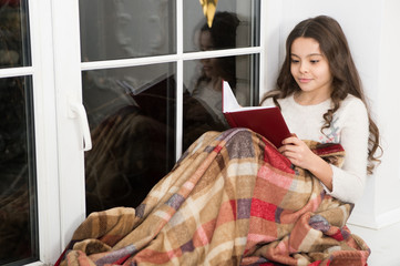 Carried away into world of fantasy. Small girl read fantasy book on windowsill. Little child enjoy reading fantasy story. Kids fantasy and imagination. Fairy tale. Read deep into night