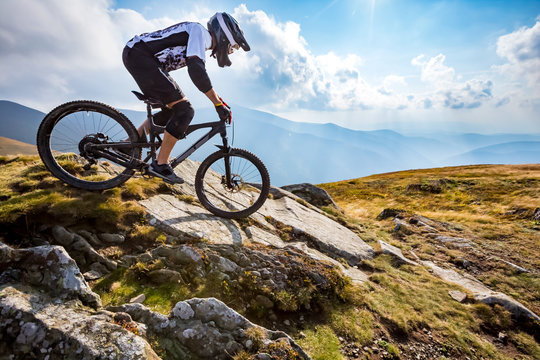 A man is riding enduro bicycle.