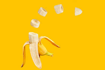Banana open and sliced with orange background