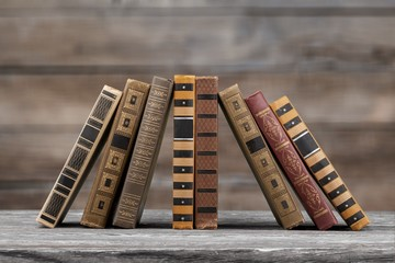 Wall Mural - Retro old stack books on wooden desk