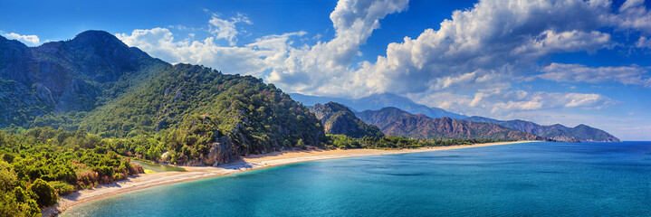 Autocollant pour porte Plage Summer mediterranean coastal landscape - view of the Cirali Olympos Beach, near the Turkish village of Cıralı, Antalya Province in Turkey