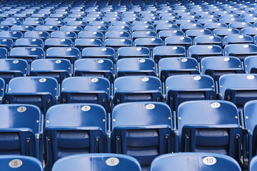 Empty blue stadium seats, empty bleachers