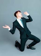Happy young business man singing