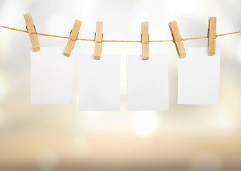 Hanging empty white card frame on a rod with background
