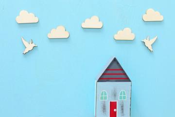 image of vintage wooden colorful house decoration on blue pastel background