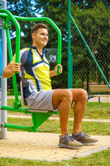 Man flexing arm in outdoor gym
