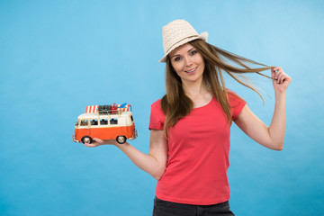 Holiday woman with camper van trailer