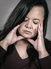 Worried woman having painfull headache