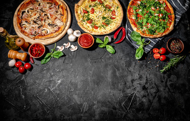 Traditional Italian pizza, vegetables, ingredients on a dark background. Top view with copy space. Pizza menu