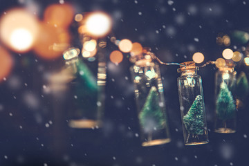 Fototapete - Close-up, Elegant Christmas tree in glass jar with snowflakes background, copy space, Christmas concept.