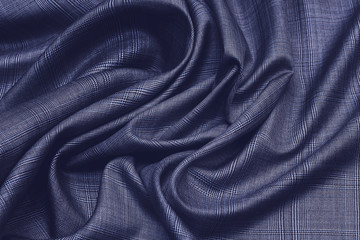Woolen fabric with silk. Suit cage. The color is blue. Background, pattern.