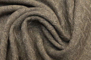 Light brown knitwear made of wool, alpaca and acrylic. Background, pattern.