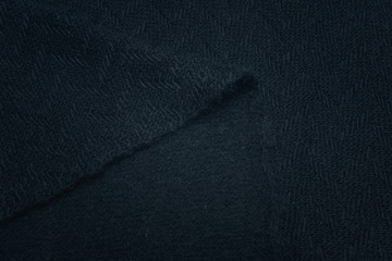 Navy blue knitwear made of wool, alpaca and acrylic. Background, pattern.