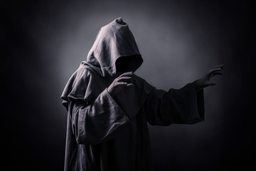 Scary figure in hooded cloak