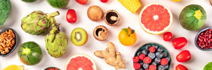 Vegan food flat lay panorama. Healthy diet concept. Fruits, vegetables, nuts, legumes, shot from the top on a white background
